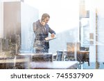 businessman in modern corporate ... | Shutterstock . vector #745537909