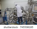 male  work the process of cream ... | Shutterstock . vector #745538185