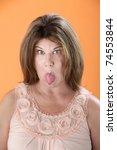 mature caucasian woman sticks... | Shutterstock . vector #74553844
