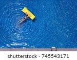 enjoying suntan. vacation... | Shutterstock . vector #745543171