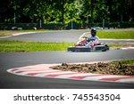 go kart racing with racer   Shutterstock . vector #745543504