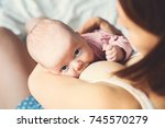 baby eating mother's milk.... | Shutterstock . vector #745570279