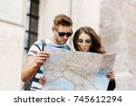 man and woman look at the map... | Shutterstock . vector #745612294
