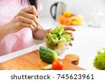 close up of woman's hands... | Shutterstock . vector #745623961