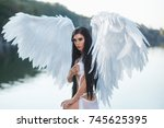 a beautiful white archangel... | Shutterstock . vector #745625395