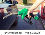 man hand holding gasoline pump... | Shutterstock . vector #745626625