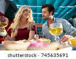happy couple at restaurant with ... | Shutterstock . vector #745635691