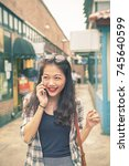 asian younger woman shopping... | Shutterstock . vector #745640599