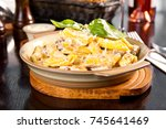 penne with cream sauce  meat...   Shutterstock . vector #745641469