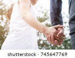 happy young asian couple... | Shutterstock . vector #745647769