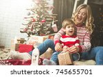 portrait of happy mother and... | Shutterstock . vector #745655701