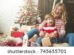 portrait of happy mother and... | Shutterstock . vector #745655701
