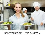 young smiling waitress holding... | Shutterstock . vector #745663957