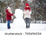 two adorable little girls... | Shutterstock . vector #745696534