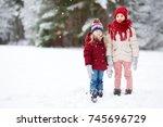 two adorable little girls... | Shutterstock . vector #745696729