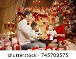 christmas family portrait ... | Shutterstock . vector #745703575