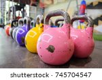 Rows Of Colorful Kettlebells I...