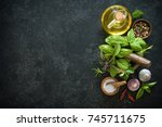 herbs and spices on black stone ... | Shutterstock . vector #745711675