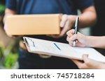 close up shot of woman hand... | Shutterstock . vector #745718284