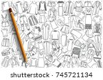 Hand drawn women's clothing vector doodle set background