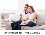 smiling young couple relaxing... | Shutterstock . vector #745728481
