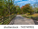 a fenced in pathway through a... | Shutterstock . vector #745749901