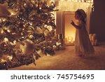child in christmas | Shutterstock . vector #745754695