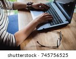 business woman typing on the...   Shutterstock . vector #745756525