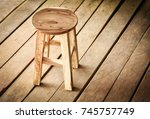 rustic round wooden stool on... | Shutterstock . vector #745757749
