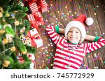 happy child in christmas time.... | Shutterstock . vector #745772929