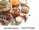 Stock photo vegan protein source legumes lentils chickpeas beans green mung bean seeds and nuts on white 745775281