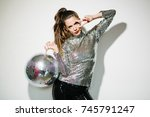 woman with disco ball  | Shutterstock . vector #745791247