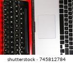 Old Typewriter Vs Laptop On...
