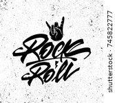 rock and roll lettering poster. ...   Shutterstock .eps vector #745822777