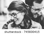 a young couple in love walking ... | Shutterstock . vector #745830415