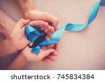adult and child hands holding... | Shutterstock . vector #745834384