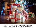 children at christmas tree and... | Shutterstock . vector #745844605