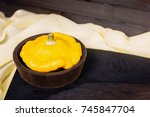 little pumpkin on a dark wooden ... | Shutterstock . vector #745847704
