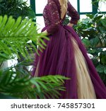 Small photo of Girl in a purple dress with a tailback view in front