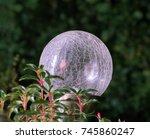 Solar Globe Sphere In A Garden...