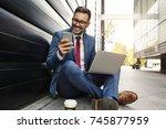 smiling businessman in suit... | Shutterstock . vector #745877959
