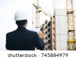 engineer or architect with... | Shutterstock . vector #745884979