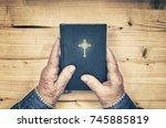 hands of old woman praying with ... | Shutterstock . vector #745885819