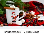 a cup of hot winter drink with... | Shutterstock . vector #745889335