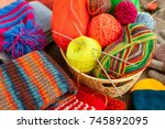 a lot of yarn and knitted...   Shutterstock . vector #745892095