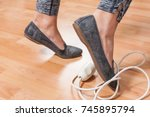 woman  caught foot in... | Shutterstock . vector #745895794