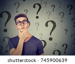 thoughtful confused handsome... | Shutterstock . vector #745900639