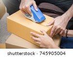 close up hands  young asian man ... | Shutterstock . vector #745905004