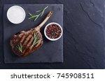 grilled tomahawk steak beef ....   Shutterstock . vector #745908511