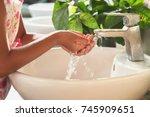children washing hand under... | Shutterstock . vector #745909651